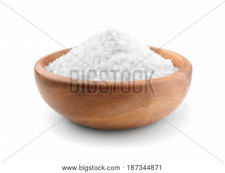 Salt in a wooden bowl isolated on white