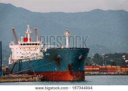 Batumi, Adjara, Georgia - May 27, 2016: Old Barge Freight Ship Tanker In Port Dock On Sunny Evening At Sunset Or Sunrise Time In Batumi, Adjara, Georgia