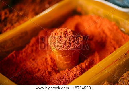 Close View Of Powdered Paprika Spice, Bright Red Color Fragrant Seasoning, Condiment In Glass And In The Tray At The East Market, Bazaar
