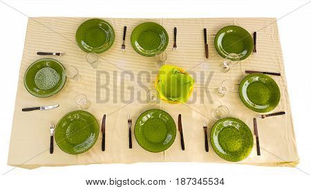 Green dishes on table ready for food to be served isolated on white.