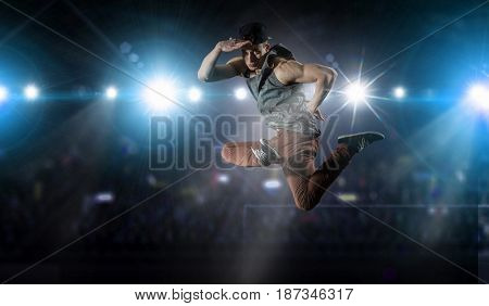 B-boy performing some moves . Mixed media . Mixed media