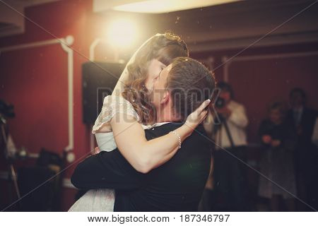 Marvelous Picture Of Newlyweds Kissing During Their First Dance