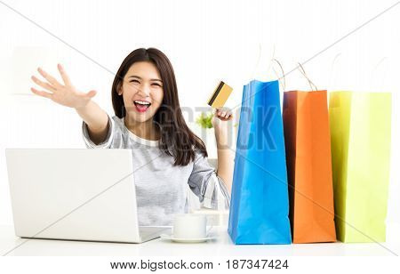 Young Woman showing credit card And Shopping Online