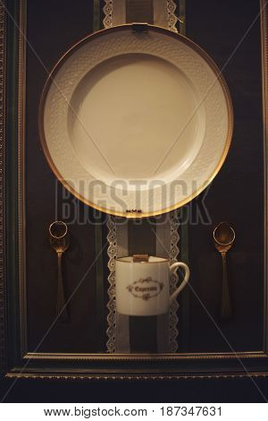 Golden rings hang over the spoons pinned to the wall
