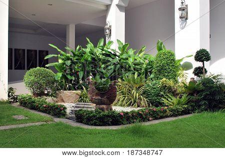 PATTAYA THAILAND - OCTOBER 09 2015: Multistorey four-star modern hotel D Varee Jomtien Beach with a beautiful landscape designed garden in Pattaya Thailand