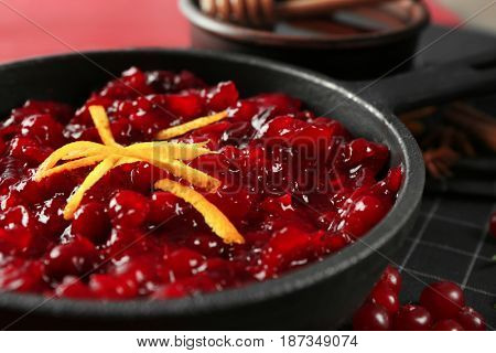 Delicious cranberry sauce in pan, close up
