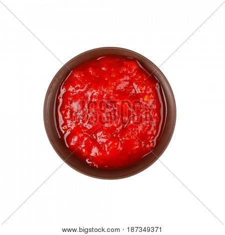 Bowl of delicious tomato sauce isolated on white