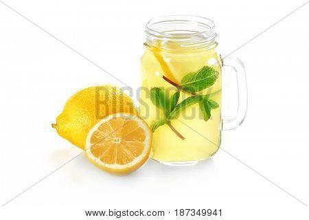 Delicious lemon juice in mason jar on white background