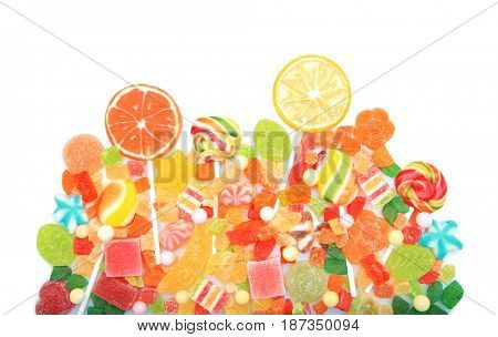 Lollipops and colorful jelly candies on white background