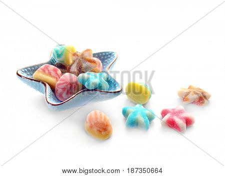 Bowl with tasty jelly candies on white background