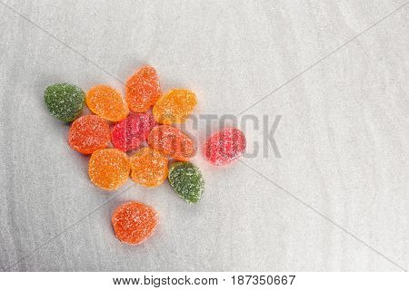 Tasty jelly candies on light background