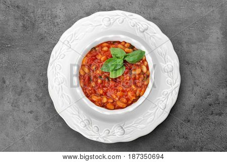 Beautiful dinnerware with delicious Italian butter beans on grey background
