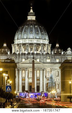 St. Peters Basilica in Rome, Italy. Via della Conciliazione (Road of the Conciliation). Papal seat. Vatican City with christmas tree. Night scene. Large depth of field. Cars trails headlights