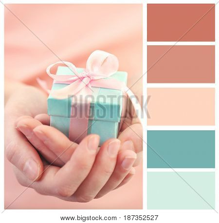 Mint color matching and woman holding gift in hands, closeup