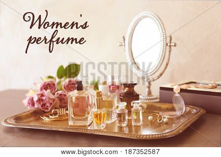Women's perfume. Tray with bottles of scent on dressing table