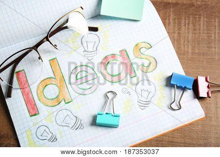 Marketing concept. Word IDEAS written in notebook
