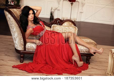 Beautiful Young Woman With Dark Hair In Luxurious Red Dress