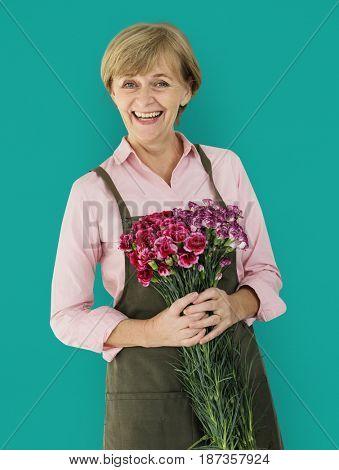 Senior Adult Woman Smiling Happiness Flower Studio Portrait