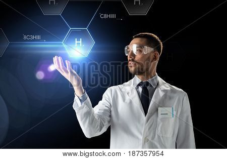 science, future technology and chemistry concept - male doctor or scientist in white lab coat and safety glasses with virtual chemical formula projection over black background