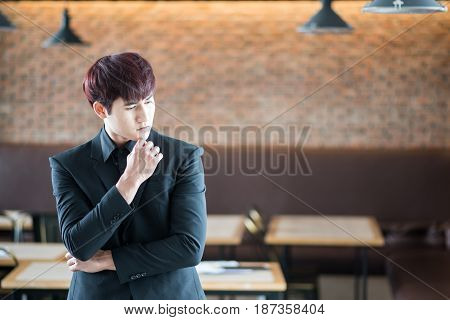 Business Man Thinking Over Solving A Problem