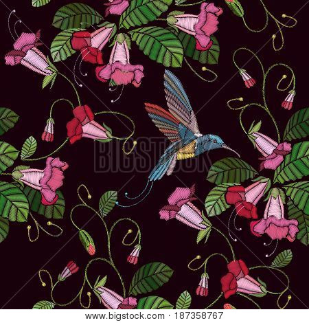 Embroidery flowers bells and humming bird seamless pattern. Fashionable template for design of clothes. Beautiful cornflowers and humming bird classical embroidery pattern