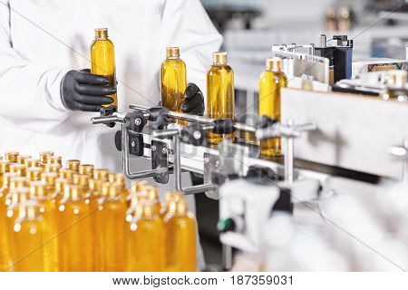 Automated Process Of Production New Cosmetic Products On Big Modern Factory. Scientist Standing Near