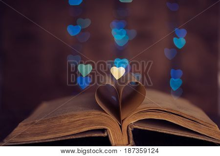 Book sheets heart and background bokeh heart