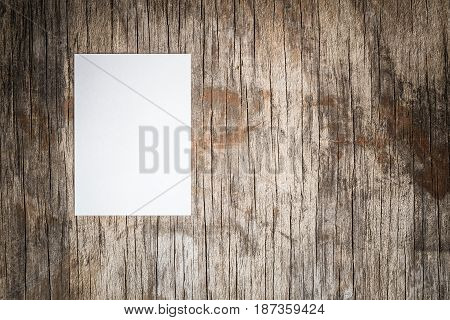 Blank sheet of paper on old wooden table,top view