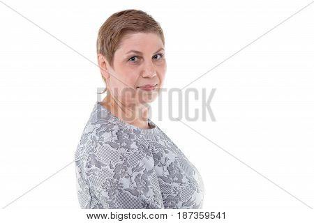Portrait of smiling senior blond woman on white background