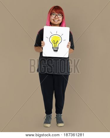 Young adult asian girl holding banner with light bulb symbol