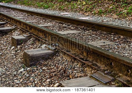The very rusty old railway track .