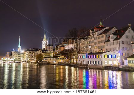 night view of the historic city center of zurich with famous fraumunster church