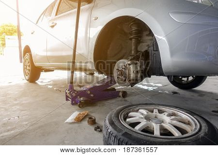 Car waiting changing wheel in auto repair shop
