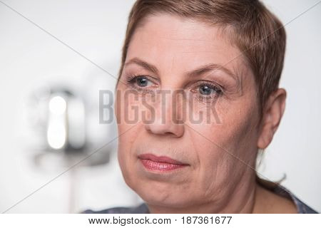 Portrait of old woman looking side, closeup on white background