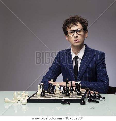 Studio portrait of successful man playing chess