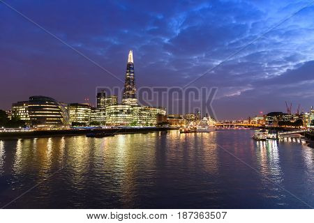 Panoramic view of london city skyline and River Thames from Tower Bridge UK in the dusk evening selective focus