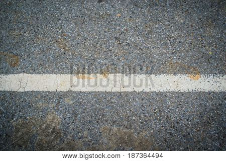 Asphalt with white road line abstract bakground