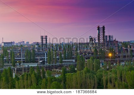 Evening Voronezh cityscape. Summer crimson sunset at industrial area of Voronezh synthetic rubber plant