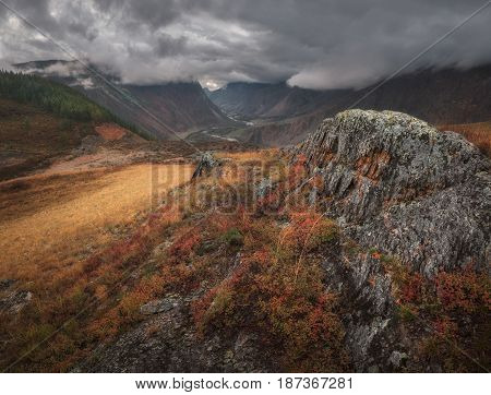 Autumn mountain landscape, low sky covering the tops of the mountains, Altai region, Siberia, Russia