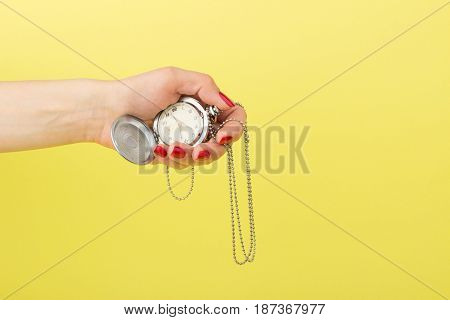 Pocket's Clock In The Woman's Hand, Yellow Background