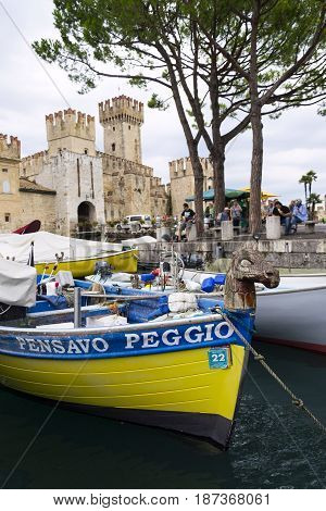 Sirmione, Italy - July 31: Boats Floating In Front Of Scaliger Castle On 31 July 2016 In Sirmione, I