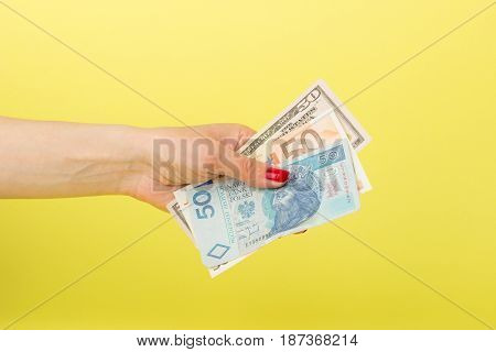 Fifty Dollars, Zloty And Euro In The Woman's Hand, Yellow Background