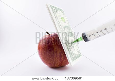 Red apple injected by transgenic and dollar.