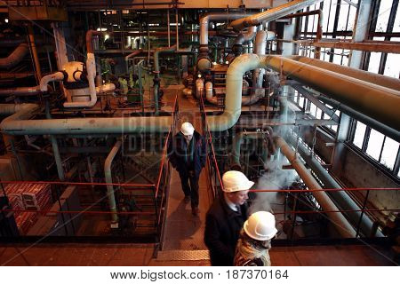 ST. PETERSBURG, RUSSIA - DECEMBER 16, 2016: People in the boiler plant Parnas. It is the largest heat energy source in Northern Europe