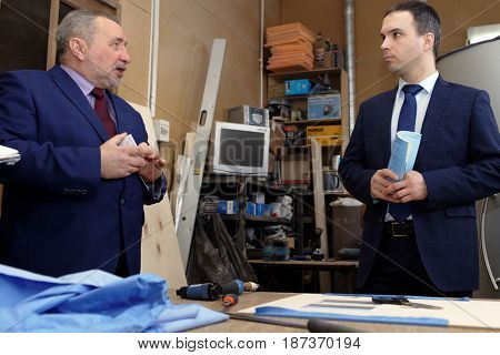 ST. PETERSBURG, RUSSIA - APRIL 13, 2017. Founder of  Krion enterprise Alexander Baranov (left) hold the press tour to its production of cryotherapy equipment. The company was founded in 1992