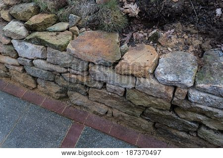 Natural stone wall dry laid with sandstone from the city of Rheine.