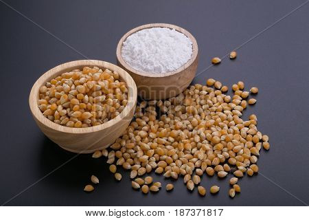 Corn In A Wooden Bowl On A Black Background