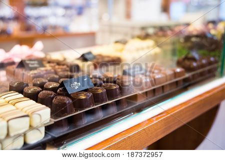 Selection Of Chocolate In A Row, Shop In Belgium