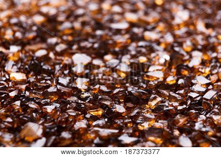 Brown Amber stones background. Close up of natural gems, jewels placer texture. Beauty, jewelry concept