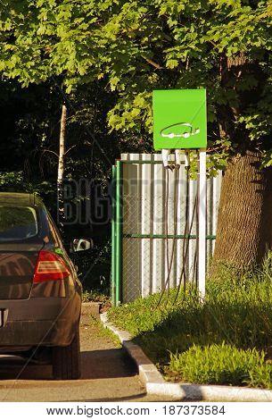 Refueling for an electric car. A car near an electric refueling. Charging electric car. Green power car.